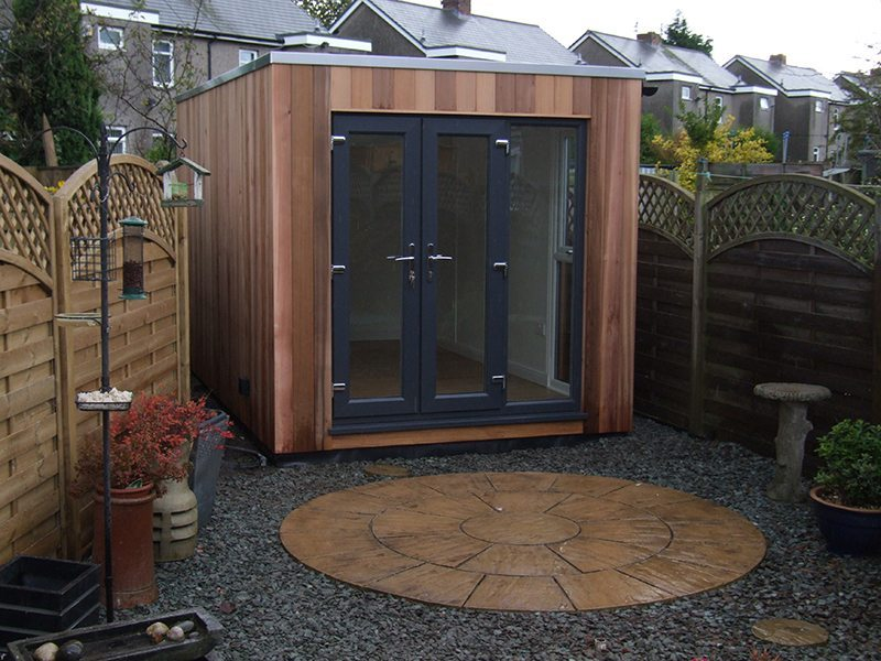 Cubed studio with French doors and fixed window