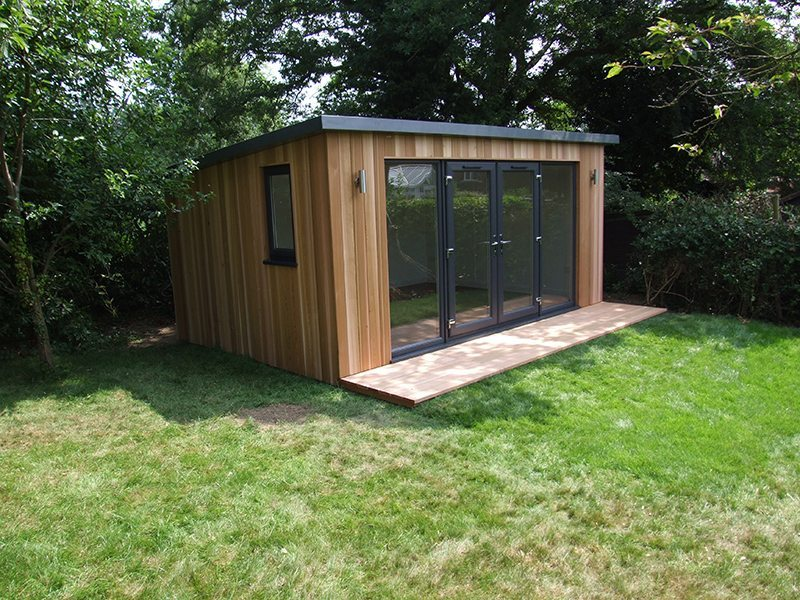 4.8m x 3.5m with overhanging roof and small decking area